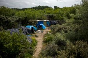 """06 juillet 2015. Calais. Laa ville est """"vidée"""" des réfugiés en les déplaçant vers une nouvelle """"jungle"""" dans la zone est dela ville . // © Olivier Touron / Divergence"""